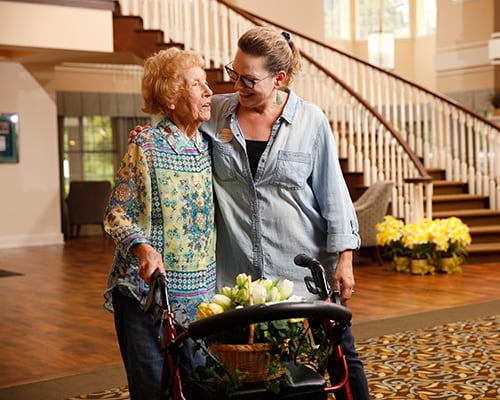 caregiver and woman in front of staircase
