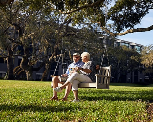 couple on bench swing