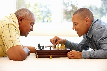 grandfather and grandson playing chess